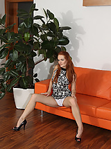 Redhead Heaven Fists Herself On the Couch For Eufrat
