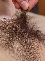 Small-titted floozy shows hairy slit