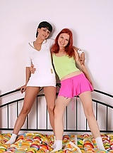 Redhead and a brunette using their strapon