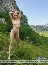 Blonde girl Katy in Swiss Mountains