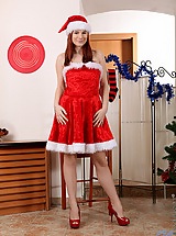 Naughty Santa hottie drills her fuck hole with a vibrator