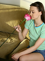 Teen teases her clit with rose petals before fingering her pussy