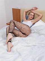 Hairy woman Felicia in black fishnet leggings