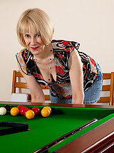 Natural Hazel bends over the pool table