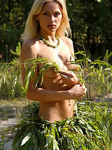 Hot and young blonde gets naked in the forest