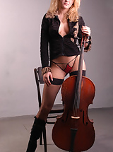 Naked Viola with cello in a photo studio